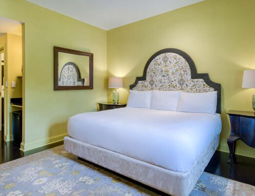 king room in hotel with bed