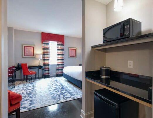 mini bar with microwave and mini fridge in hotel room
