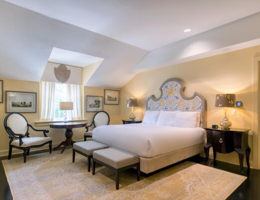 large king bed in hotel suite with seating area beside