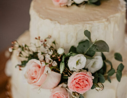 wedding cake decorated with fresh pink roses