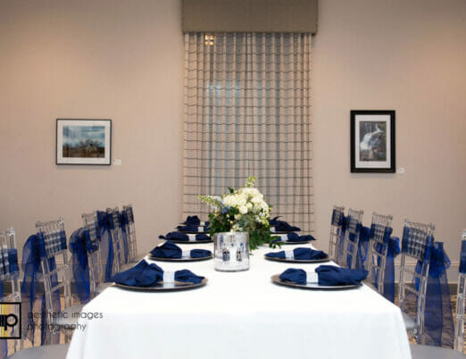 meeting area prepared for dining wedding event with table settings