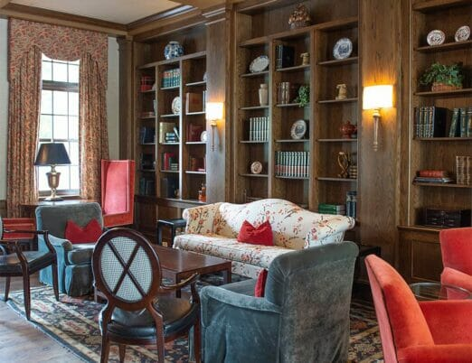 glamorous library living space in dark oak room