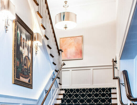 boutique hotel stairway with artwork accenting bright white walls