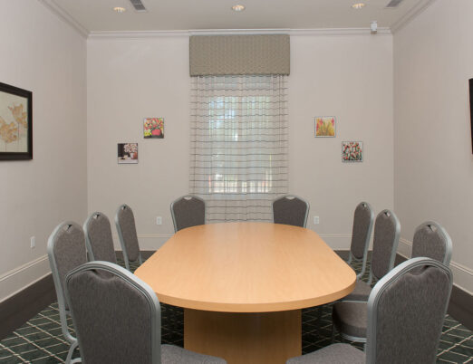 conference room with long table and 10 chairs