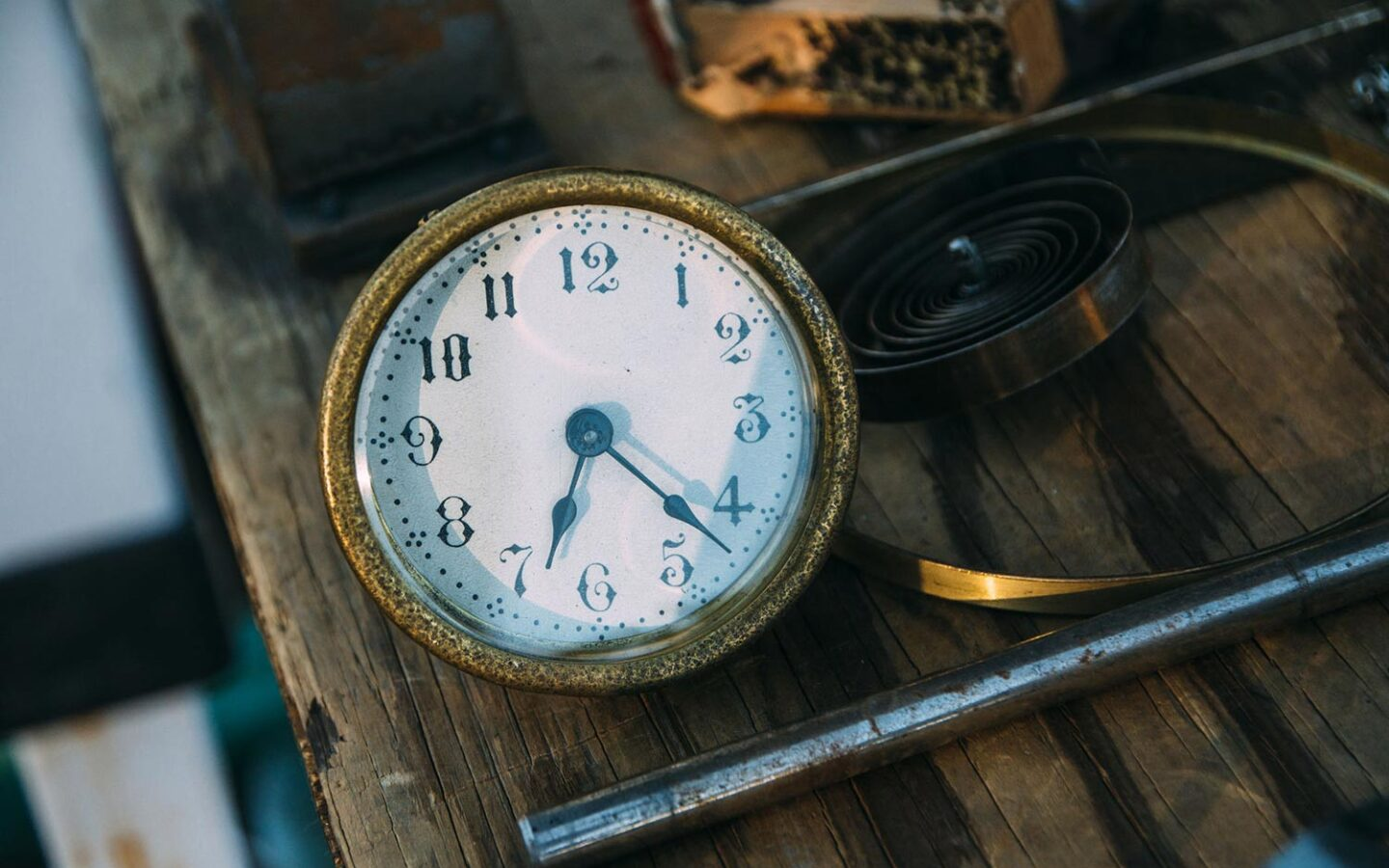 old watch sitting on wooden table