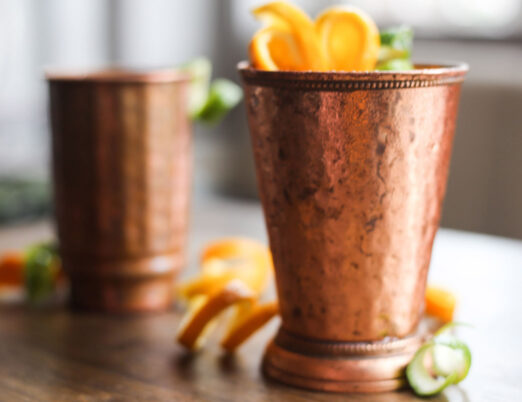 copper cocktail glass with garnish