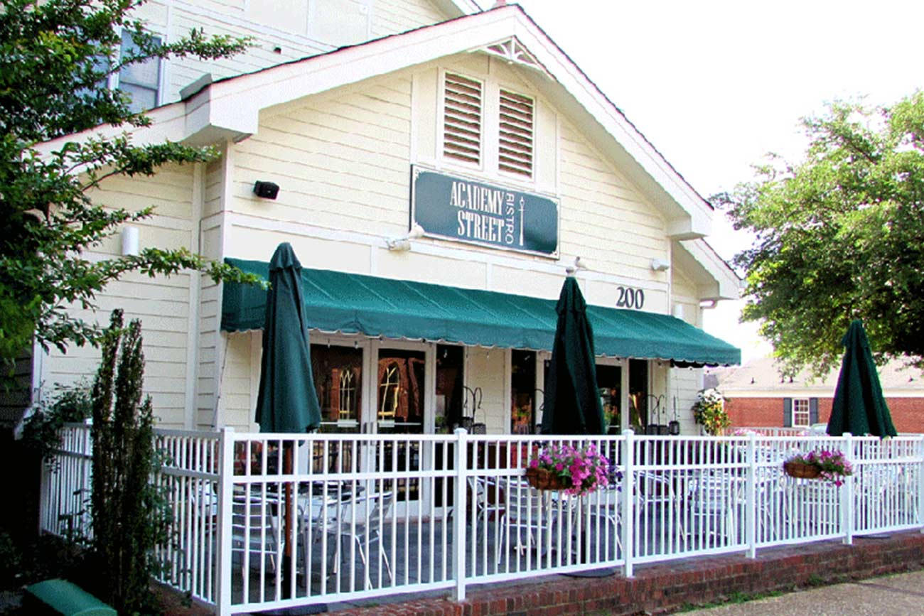 the exterior of the Academy Street Bistro in Cary, NC with outdoor seating area