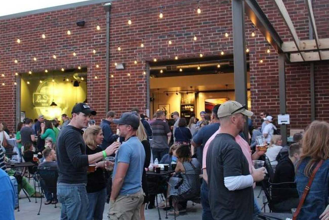 people gathered in the outdoor seating area of Bond Brothers Brewery in Cary, NC