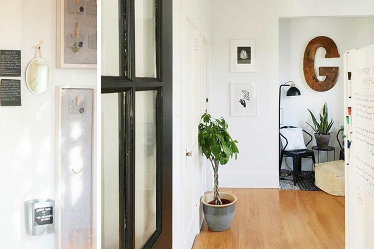 a bright art studio with wooden floors and art hanging white walls