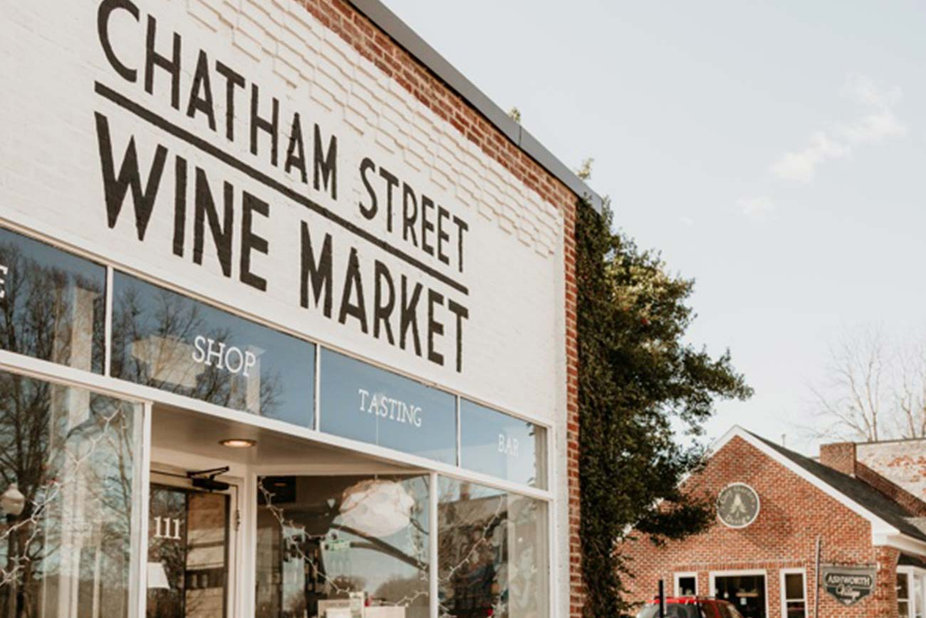exterior of Chatham Street Wine Market, a one storey brick building in Cary, NC