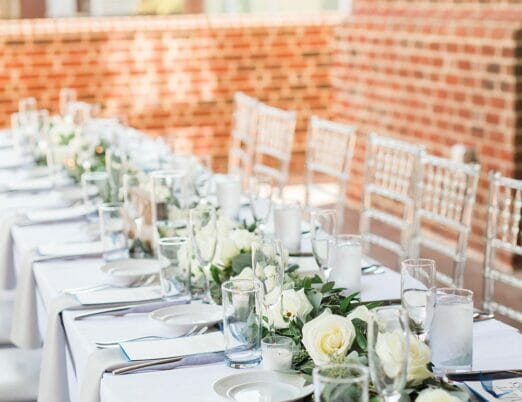 long table for dining at wedding reception on outdoor veranda