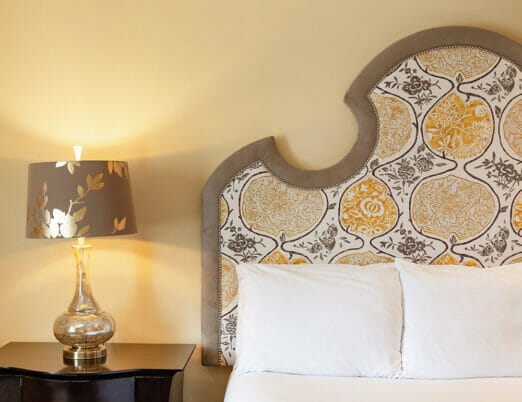 close up of hotel bed and nightstand