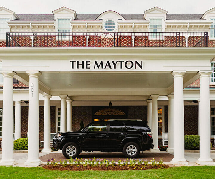 black suv parked at the entrance of the mayton